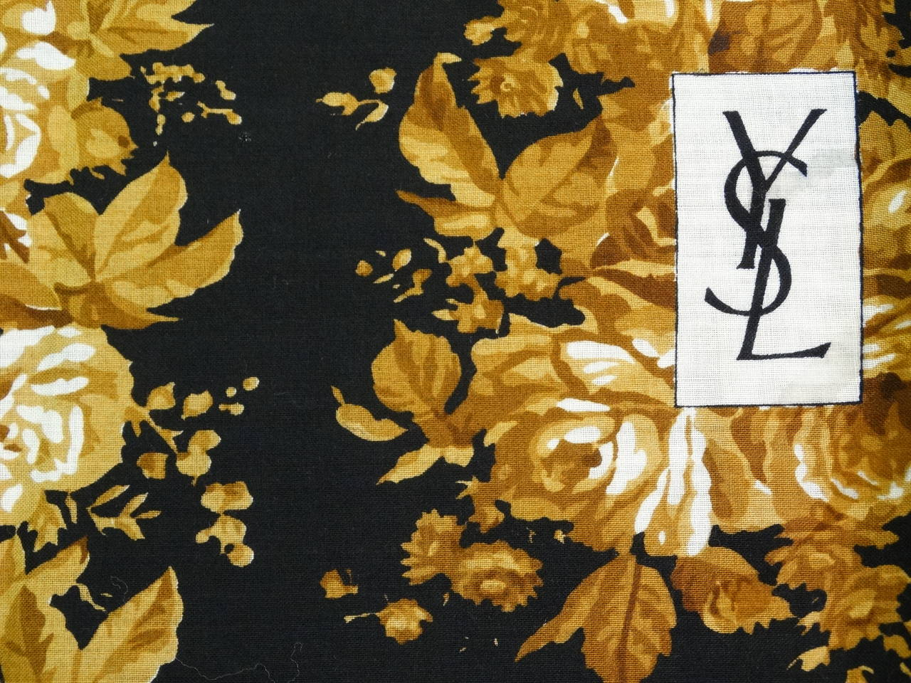 Perfect color combo and print for fall on this fabulous 1970's Yves Saint Laurent Wool Challis Shawl. A beautiful rose pattern enliven this wool and silk blend piece. Scarf, Shawl is in excellent condition and has rolled hand-stiched edges all the
