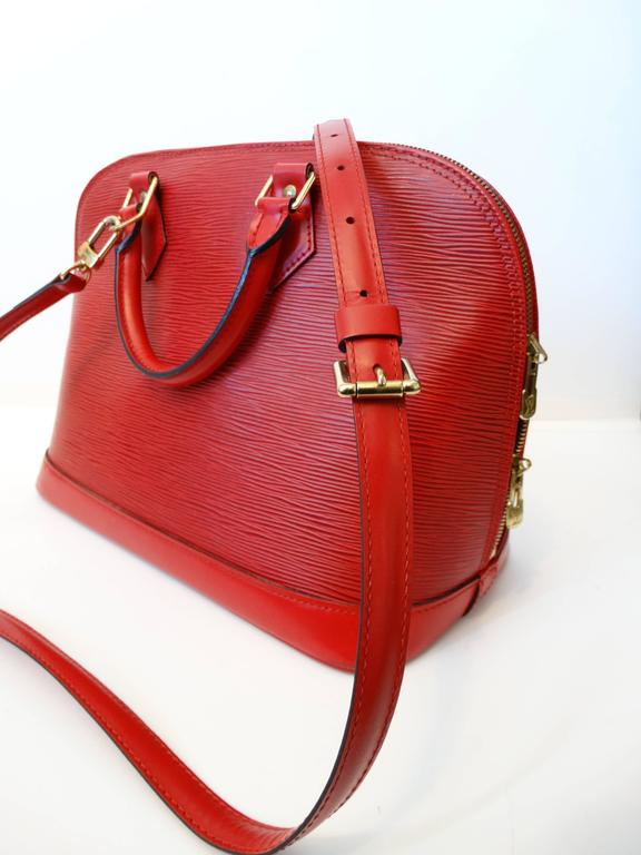 Women's 1990s Louis Vuitton Epi Alma PM Castilian Red Handbag  For Sale