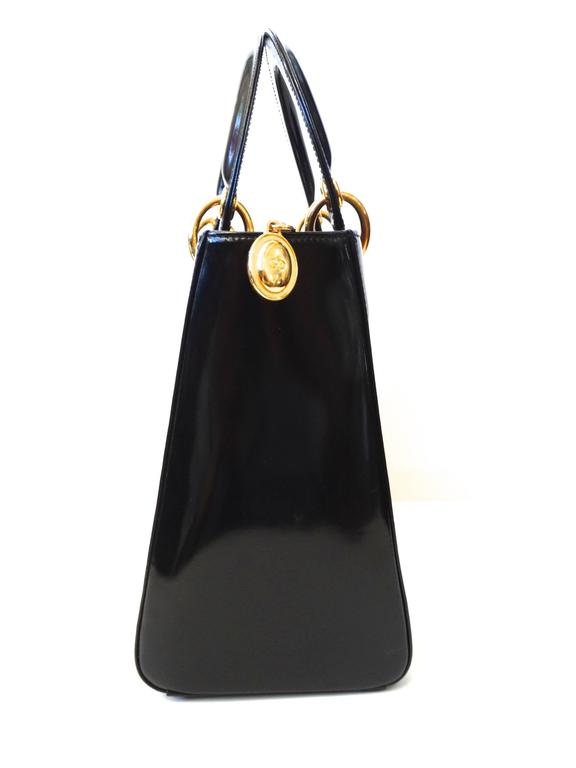 """The biggest """"it bag"""" of the 20th century, this is an authentic CHRISTIAN DIOR Vintage Patent Medium Lady Dior in Black created in 1995 via John Galliano. This lovely vintage medium sized tote is smooth black patent leather. The tote features"""