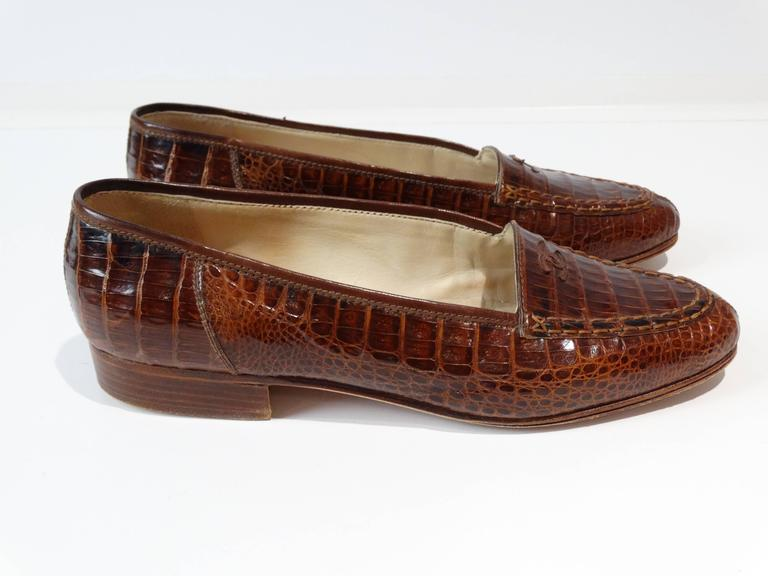 A beautiful pair of 1980s Chanel Crocodile slip on loafers in a deep coniac  color. These lovelies have medium CC on the top front. Very little wear, marked a size 38. Only one previous owner