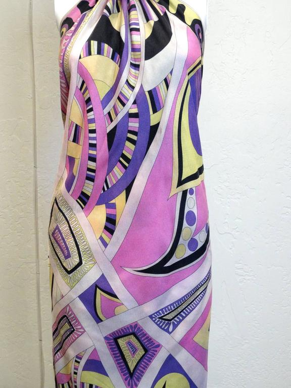 This gorgeous 60's scarf dress made from a large Emilio Pucci silk scarf has one seam for the neck ribbon and one seam at the back to hold the scarf together. (The seam can be easily adjusted for a better fit.) Light as a feather and a perfect