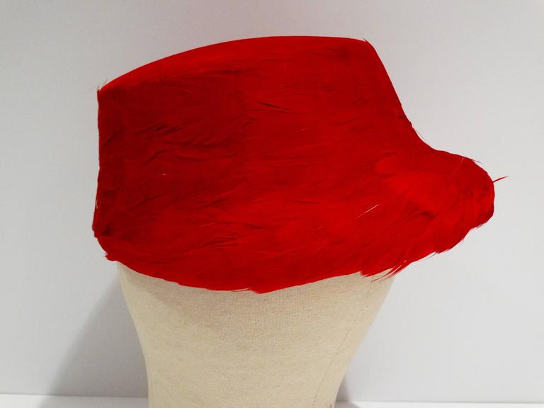 "Sassy 1950's Clover Lane feathered hat with felt top. In lipstick red, this hat is very avant guard and looks stunning on. In mint condition Size of the hat...across the top (not counting the brim) it measures 6 1/4""."