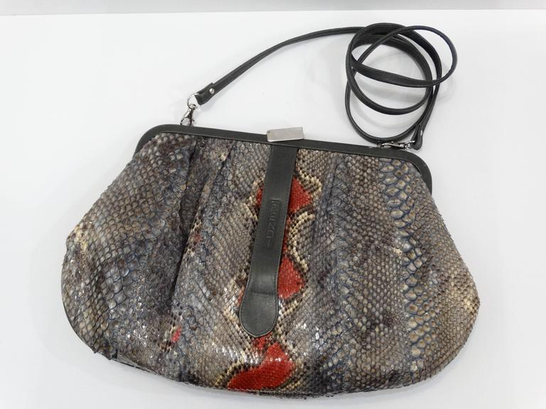 Incredible 1980s Fendi snakeskin clutch handbag in grey and red with grey leather accents. Fully lined interior with zip pocket. Tuck in the long strap to wear as a clutch or wear as crossbody.  Top frame secured with a silver clasp, minor wear on