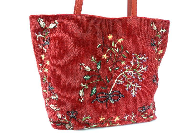 A beautiful and rare Valentino embroidered and beaded tote handbag designed by Maria Grazia Chiuri & Pierpaolo Picciol for Valentino's 1999 collection. LABELED 'VALENTINO GARAVANI'This tote is embroidered and covered in Valentino red glass beads