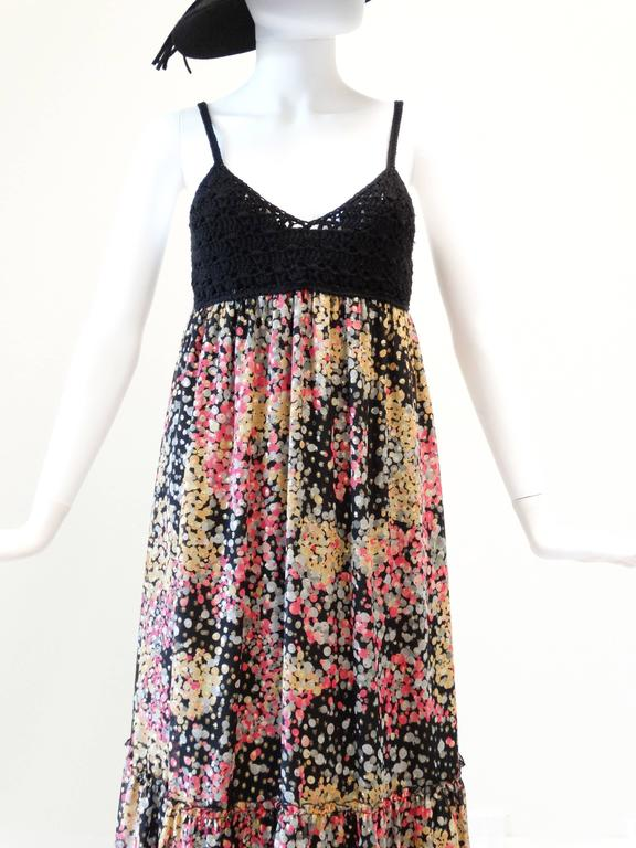 If you love Missoni this maxi is for you! Beautiful crochet top that ends under the bust. Maxi is empire waist with a beautiful confetti print with gold lame through out. Lined in silk... Marked size small  Measurements:  Bust 32-34 Waist 27