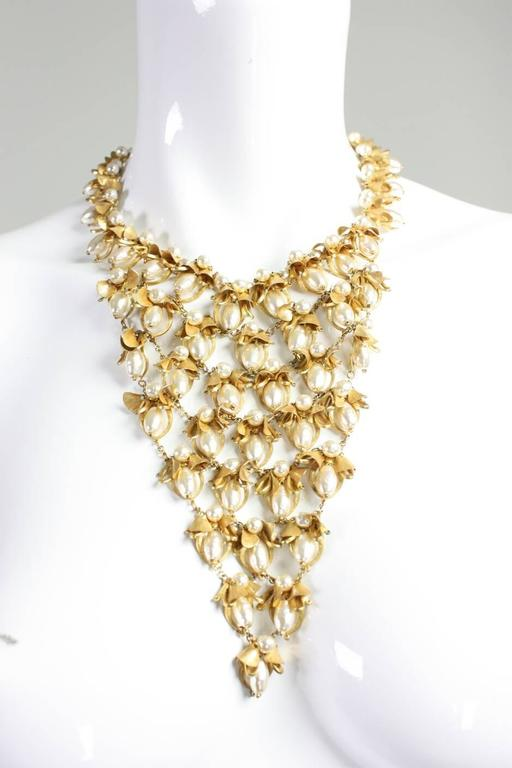 """Vintage necklace from Miriam Haskell likely dates from the 1950's to the 1960's and is made of gold-toned metal with faux fresh water pearls.  Signature filigree round box clasp.  Measurements-  Center front: 6 3/4"""" Circumference: 17"""""""