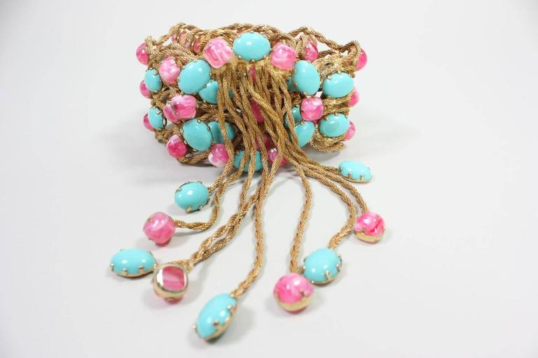 Vintage belt from Kenneth Jay Lane dates to the 1960's and is made of cotton candy pink and light turquoise cabochons. 