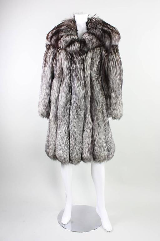 Vintage silver fox fur likely dates to the 1980's through 1990's and was manufactured by NH Rosenthal Furs in Chicago.  Lined with black satin.  Hip pockets with velvet lining.    Condition: Excellent condition.  Stored in climate controlled