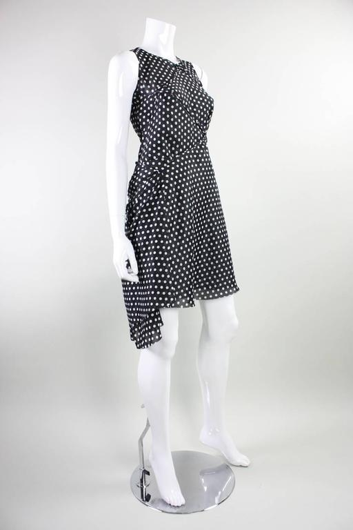 "Gorgeous dress by Junya Watanabe for Comme des Garcons dates to 2003 and is made of black dotted chiffon that is manipulated through draping and gathering.  Somewhat lined.  No closures.  Measurements- Bust: 34"" Waist: 30"" Hip: 36"" Center Back"