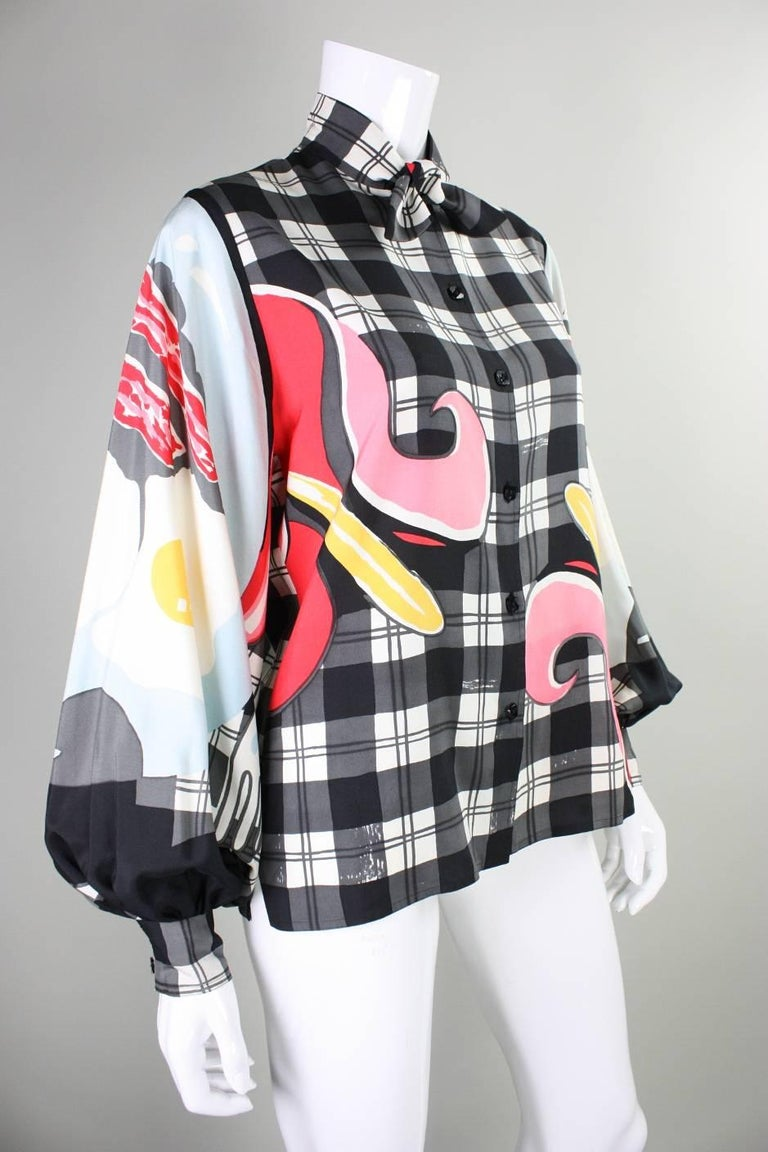 Vintage blouse from Michaele Vollbracht dates to the 1980's and features his iconic graphic breakfast print.  Long sleeves have double button cuffs.  Center front button closure.  Unlined.