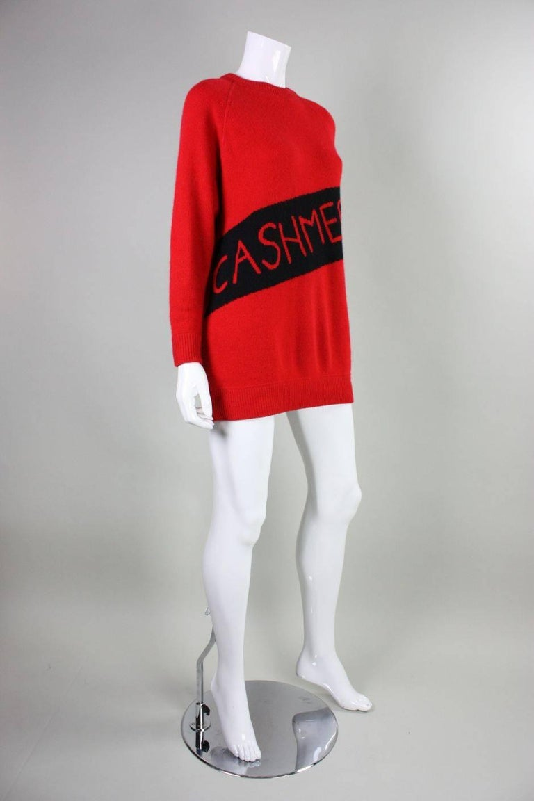 """Vintage sweater from William Kasper California dates to the 1980's through early 1990's and is made of red cashmere wool.  It humorously has the word """"Cashmere"""" woven diagonally across the front so that everyone knows that you are wearing"""