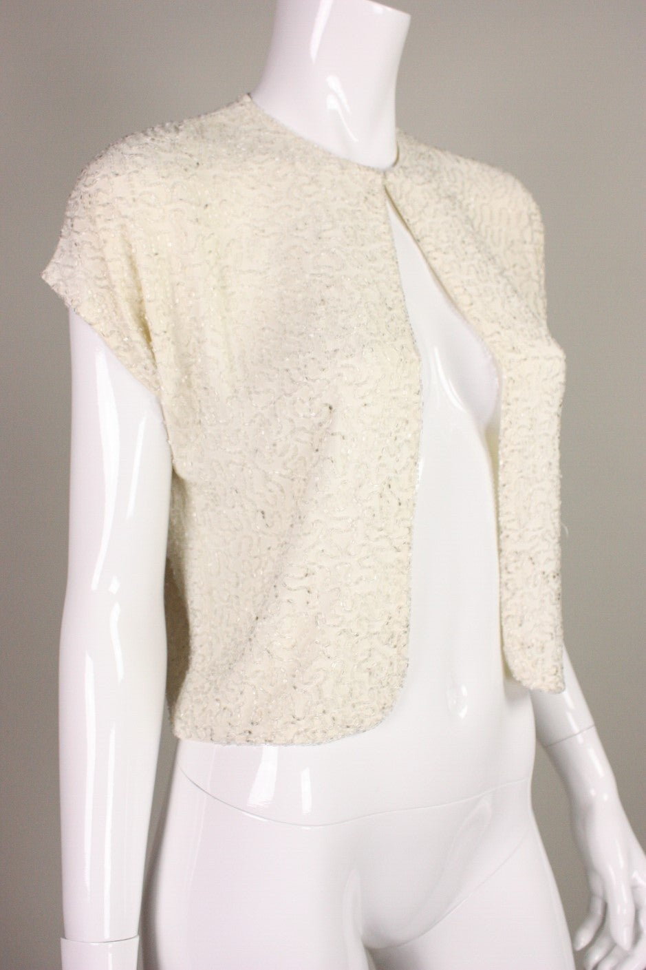 1940's Beaded Cream Jacket. Unlined.  Center front hook and eye closure at neckline.