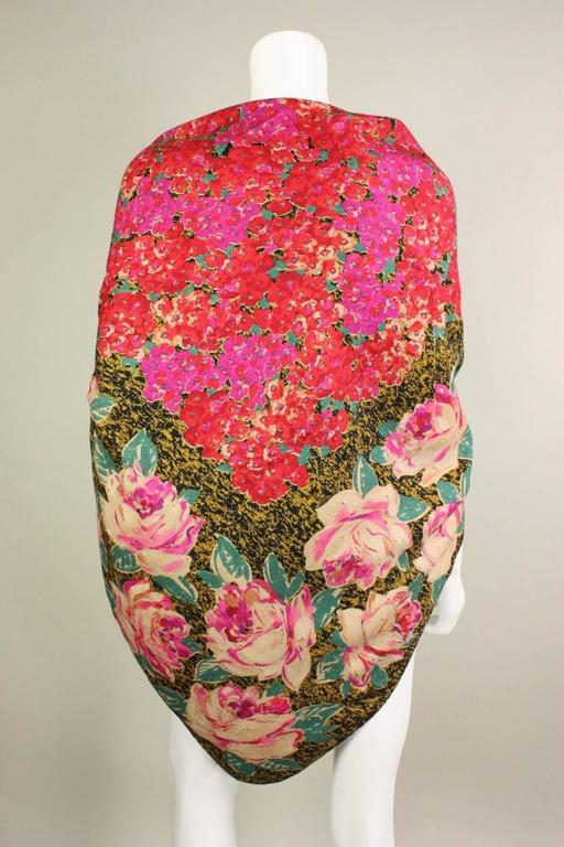 """Vintage wool shawl from Emanuel Ungaro dates to the 1980's and is made of a lightweight wool with a bright floral print.  Rolled edges are hand-stitched.  Measures 54"""" square."""