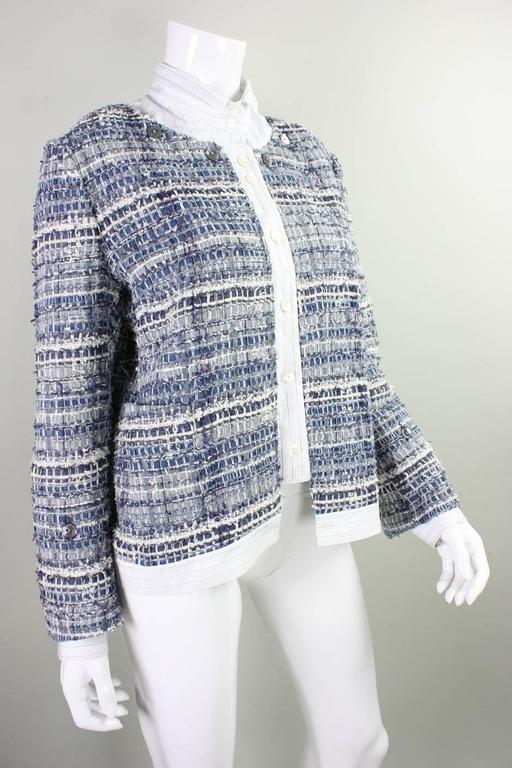 Jacket from Dolce & Gabbana likely dates to the 2000's and is made of different tones and textures of denim.  It features an attached placket and cuffs made from a white shirting material.  Detachable collar fastens with buttons around neckline.