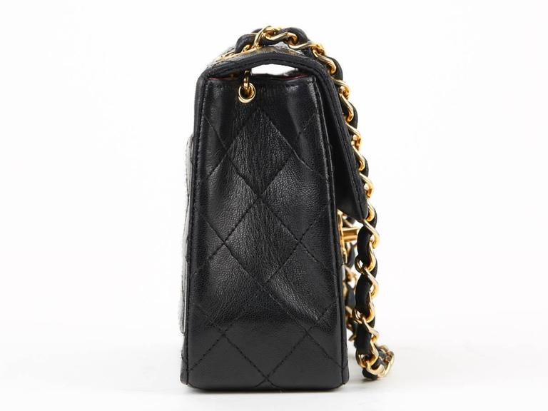 1980s Chanel Black Quilted Lambskin Vintage Mini Flap Bag In Excellent Condition For Sale In Bishop's Stortford, GB