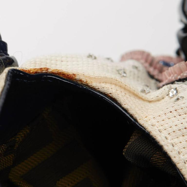 """""""FENDI Multicolour Embelished Floral Spy Bag  This FENDI Spy Bag is in Very Good Pre-Owned Condition accompanied by Fendi Dust Bag. Circa 2007. Primarily made from Embelishment complimented by Silver hardware. Our Xupes reference is HB571 should"""