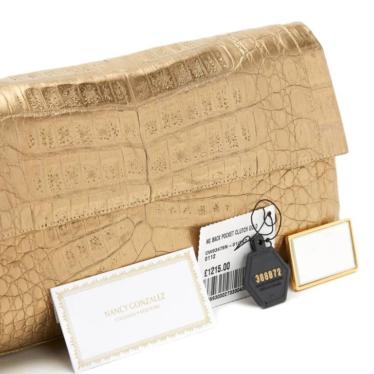 2000s Nancy Gonzalez Gold Crocodile Leather Clutch For Sale 1
