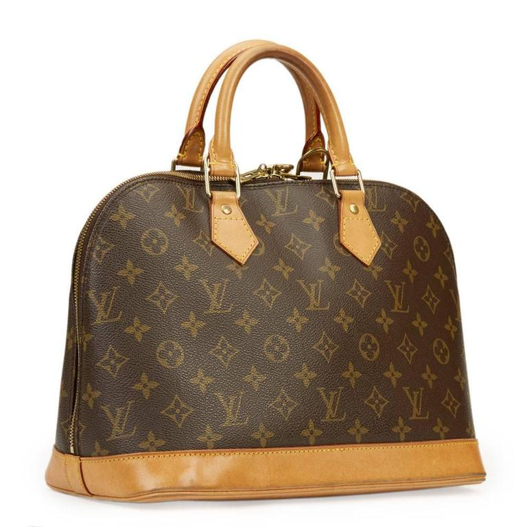 LOUIS VUITTON Xupes x Year Zero London Handpainted Ca$h Money 'For the Love of Money' Alma PM 3/3  This LOUIS VUITTON Alma PM is in Good Pre-Owned Condition accompanied by Padlock & Keys. Circa 2002. Primarily made from Coated Canvas complimented by