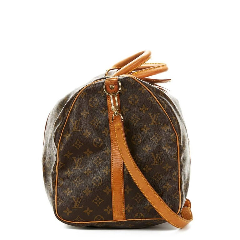 11215879c056 LOUIS VUITTON Brown Coated Monogram Canvas Vintage Keepall Bandouliere 55  This LOUIS VUITTON Keepall Bandouliere 55