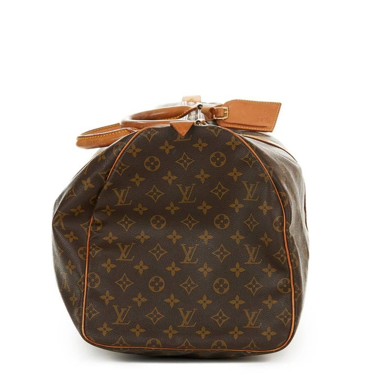 LOUIS VUITTON Brown Coated Monogram Canvas Vintage Keepall 55  This LOUIS VUITTON Keepall 55 is in Good Pre-Owned Condition accompanied by Luggage Tag. Circa 1987. Primarily made from Coated Canvas complimented by Golden Brass hardware. Our Xupes