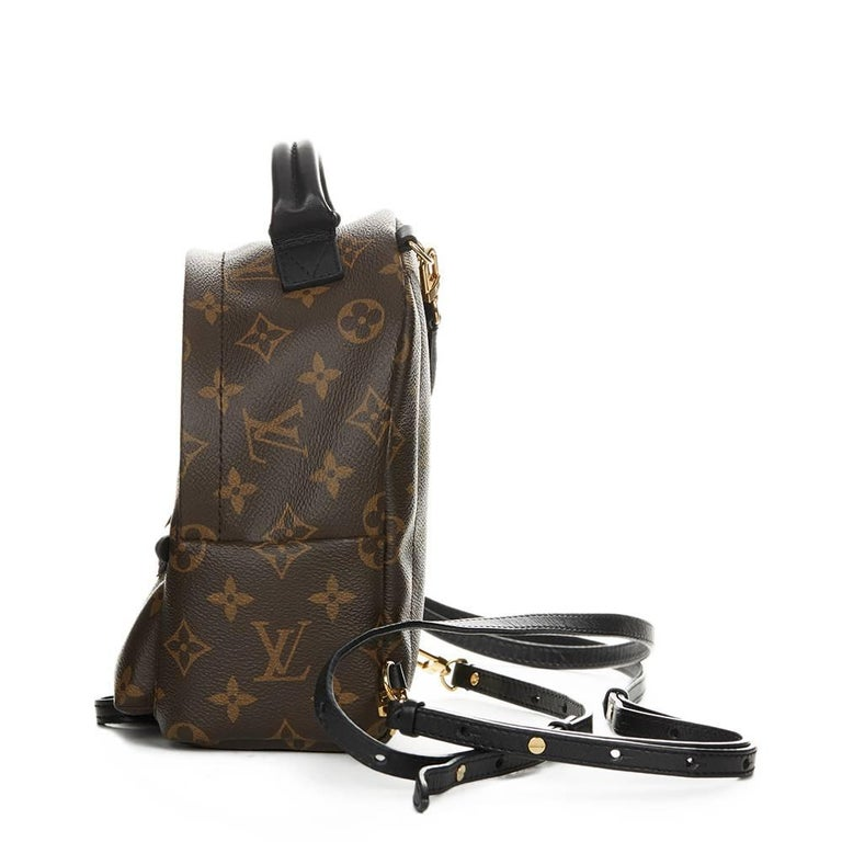 LOUIS VUITTON Brown Monogram Coated Canvas Palm Springs Backpack PM This LOUIS  VUITTON Palm Springs Backpack fbeb7ad758