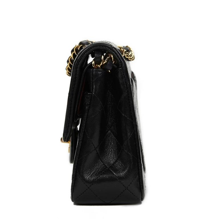 CHANEL Black Quilted Lambskin Vintage Small Classic Double Flap Bag  Xupes Reference: HB653 Serial Number: 1948478 Age (Circa): 1990 Authenticity Details: Serial Sticker (Made in France) Gender: Ladies Type: Shoulder  Colour: Black Hardware: Gold