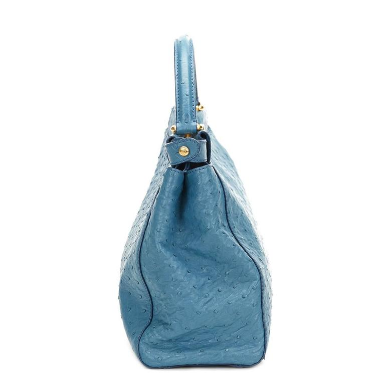 FENDI Blue Ostrich Leather Small Peekaboo  This FENDI Small Peekaboo is in Excellent Pre-Owned Condition accompanied by Shoulder Strap. Circa 2000'S. Primarily made from Ostrich Leather complimented by Gold hardware. Our Xupes reference is HB439