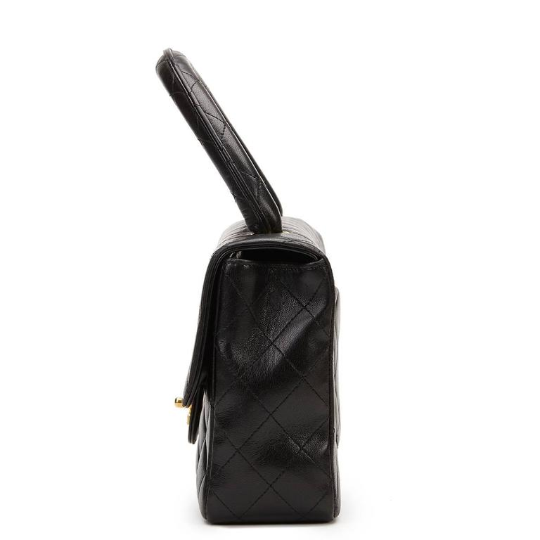 CHANEL Black Quilted Lambskin Vintage Timeless Kelly  This CHANEL Timeless Kelly is in Excellent Pre-Owned Condition accompanied by Chanel Dust Bag, Authenticity Card. Circa 1994. Primarily made from Lambskin Leather complimented by Gold hardware.