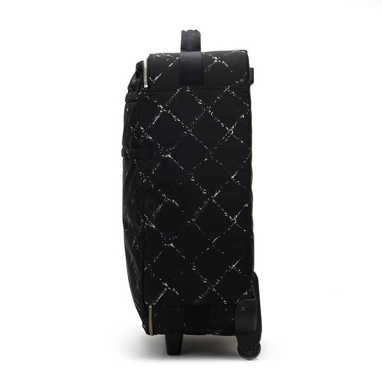 CHANEL Black & White Nylon Waterproof Travel Line Rolling Case  This CHANEL Rolling Case is in Excellent Pre-Owned Condition. Circa 2001. Primarily made from Nylon complimented by Silver hardware. Our Xupes reference is HB979 should you need to