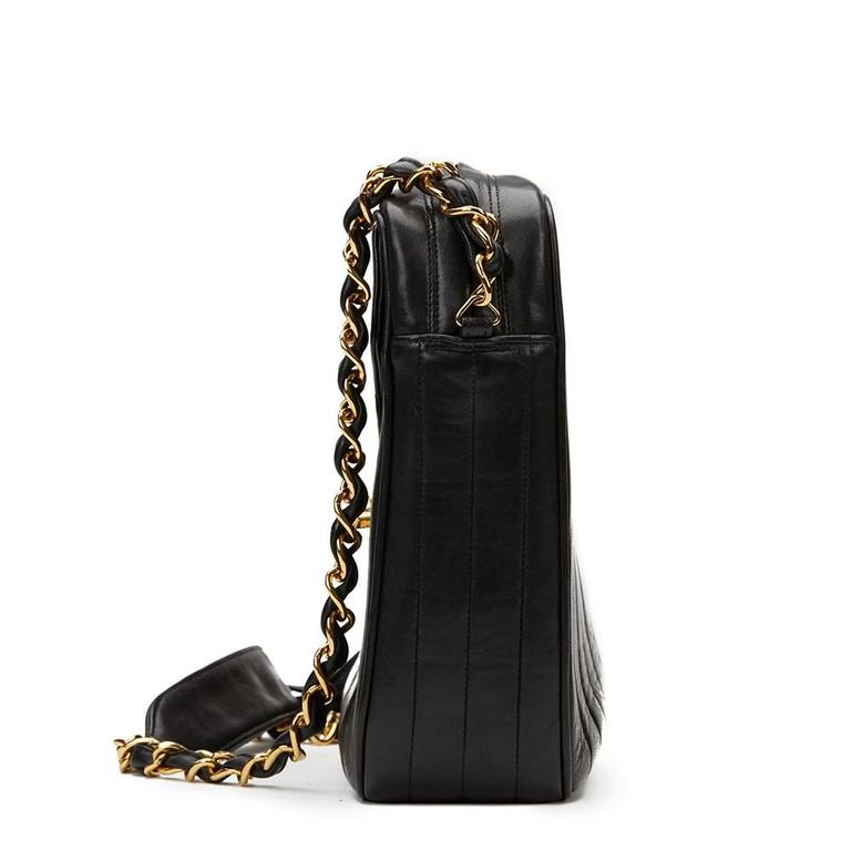 e2d712396c191b CHANEL Black Vertical Quilted Lambskin Vintage Jumbo XL Fringe Camera Bag  Xupes Reference: HB982 Serial