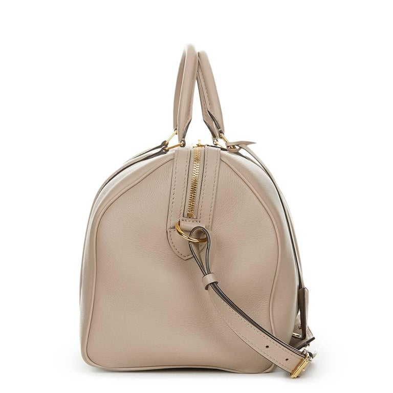LOUIS VUITTON Taupe Cachemire Leather Sofia Coppola MM  This LOUIS VUITTON Sofia Coppola MM is in Excellent Pre-Owned Condition accompanied by Louis Vuitton Dust Bag, Lock, Keys, Clochette. Circa 2013. Primarily made from Cachemire Leather