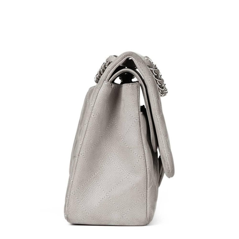 CHANEL Grey Quilted Caviar Suede Jumbo Classic Double Flap Bag  This CHANEL Jumbo Classic Double Flap Bag is in Good Pre-Owned Condition accompanied by Chanel Dust Bag. Circa 2012. Primarily made from Caviar Suede complimented by Silver hardware.