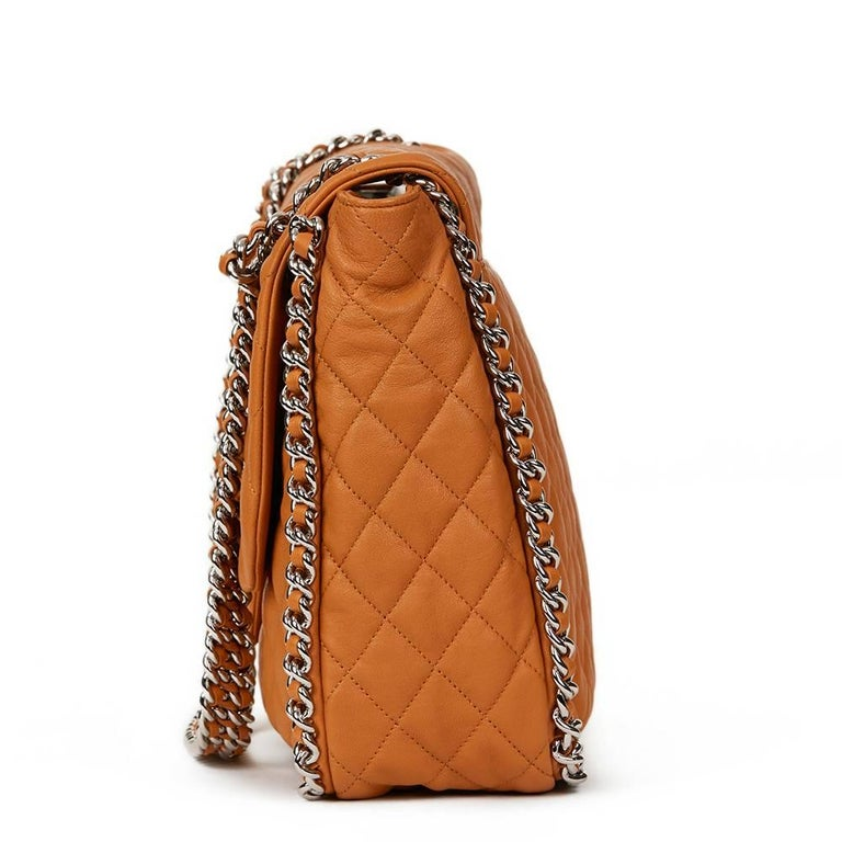 CHANEL Honey Beige Quilted Calfskin Chain Around Maxi Flap Bag  This CHANEL Chain Around Maxi Flap Bag is in Excellent Pre-Owned Condition. Circa 2012. Primarily made from Calfskin Leather complimented by Silver hardware. Our Xupes reference is