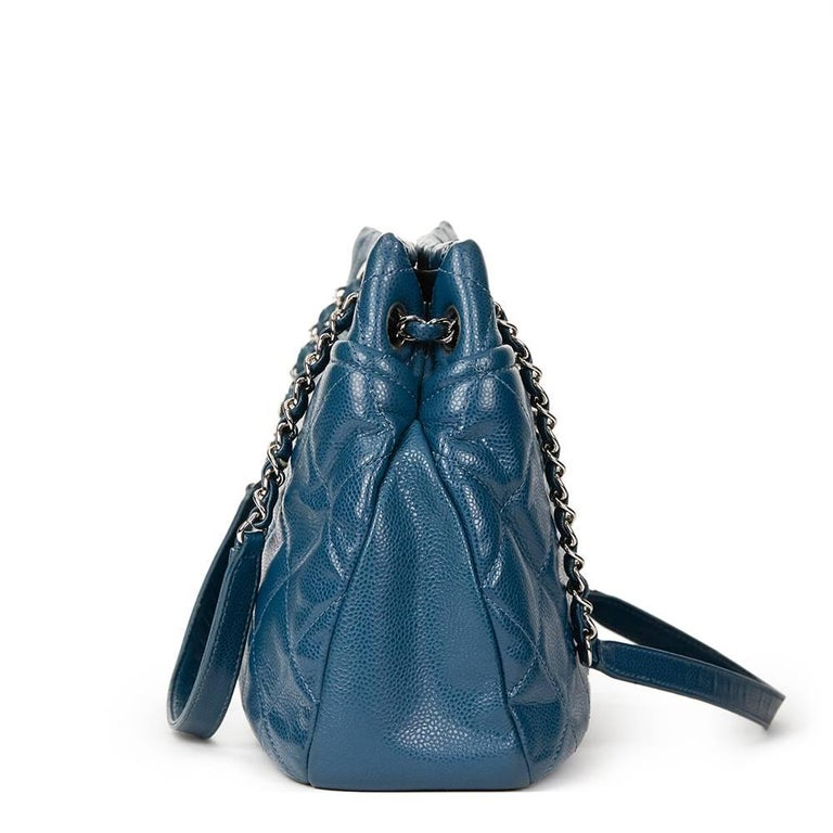 """""""CHANEL Turquoise Quilted Caviar Leather Timeless Shoulder Bag  This CHANEL Timeless Shoulder Bag is in Very Good Pre-Owned Condition accompanied by Chanel Dust Bag. Circa 2012. Primarily made from Caviar Leather complimented by Silver hardware. Our"""
