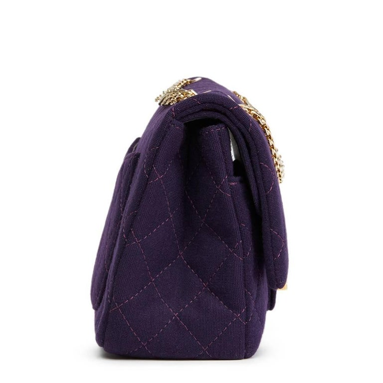 """""""CHANEL Violet Quilted Jersey Fabric 2.55 Reissue 226 Double Flap Bag  This CHANEL 2.55 Reissue 226 Double Flap Bag is in Excellent Pre-Owned Condition accompanied by Authenticity Card. Circa 2013. Primarily made from Jersey Fabric complimented by"""