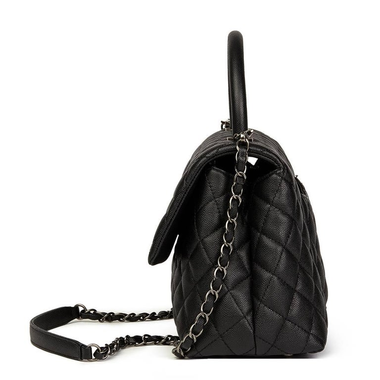 """""""CHANEL Black Quilted Caviar Leather Medium Coco Handle  This CHANEL Medium Coco Handle is in Excellent Pre-Owned Condition accompanied by Chanel Dust Bag, Box, Authenticity Card, Detachable Shoulder Strap. Circa 2017. Primarily made from Caviar"""