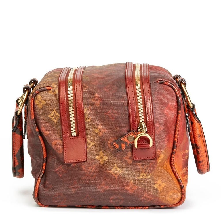 """""""LOUIS VUITTON Acid Coated Canvas & Karung Snakeskin Mancrazy Jokes  This LOUIS VUITTON Mancrazy Jokes is in Excellent Pre-Owned Condition accompanied by Louis Vuitton Dust Bag. Circa 2008. Primarily made from Coated Canvas, Karung Snakeskin"""
