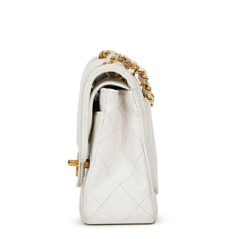 CHANEL White Quilted Lambskin Vintage Small Classic Double Flap Bag  This CHANEL Small Classic Double Flap Bag is in Good Pre-Owned Condition accompanied by Chanel Dust Bag, Authenticity Card. Circa 1990. Primarily made from Lambskin Leather
