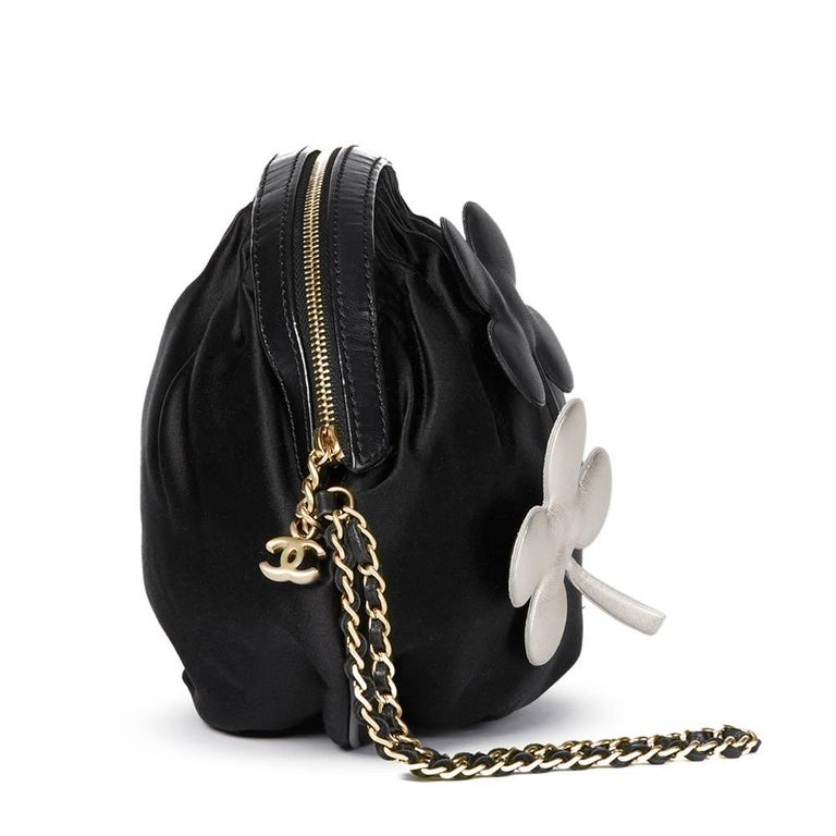 """""""CHANEL Black Satin Four Leaf Clover Timeless Wristlet Clutch  This CHANEL Timeless Wristlet is in Very Good Pre-Owned Condition accompanied by Chanel Dust Bag. Circa 2004. Primarily made from Satin complimented by Matte Gold hardware. Our"""