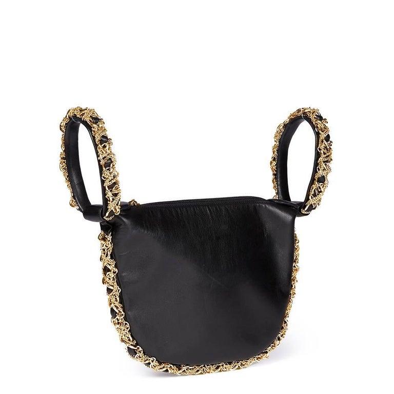 2013 Chanel Black Lambskin Chain Around Timeless Wristlet  In Excellent Condition For Sale In Bishop's Stortford, Hertfordshire
