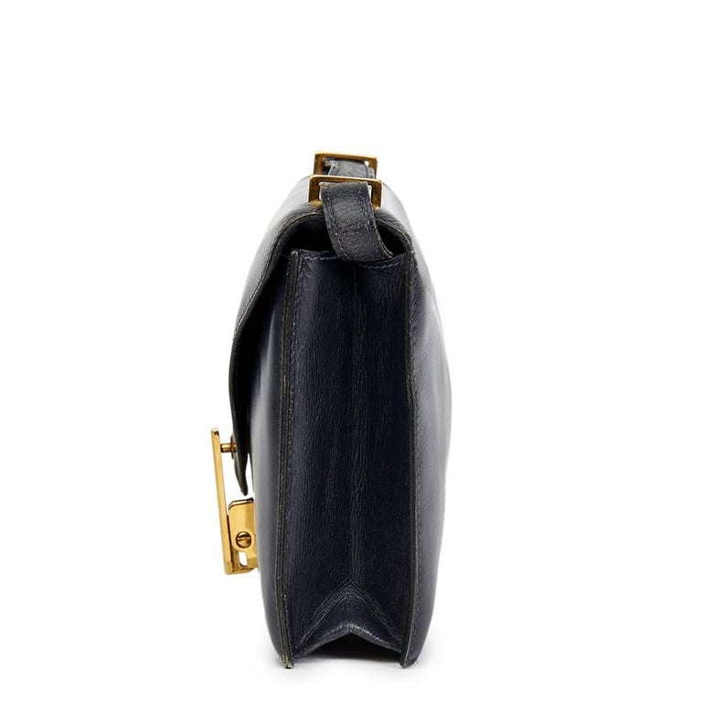 HERMES Navy Box Calf Leather Vintage Jimmy  This HERMES Jimmy is in Good Pre-Owned Condition accompanied by Hermes Dust Bag. Circa 1968. Primarily made from Box Calf Leather complimented by Gold hardware. Our Xupes reference is HB1477 should you