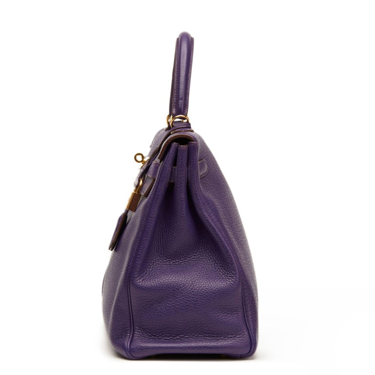 HERMÈS Violet Togo Leather Kelly 35cm Retourne  Xupes Reference: HB1117 Serial Number: [N] Age (Circa): 2010 Accompanied By: Lock, Keys, Clochette, Shoulder Strap, Hermès Spa Receipt Authenticity Details: Date Stamp (Made In France) Gender: