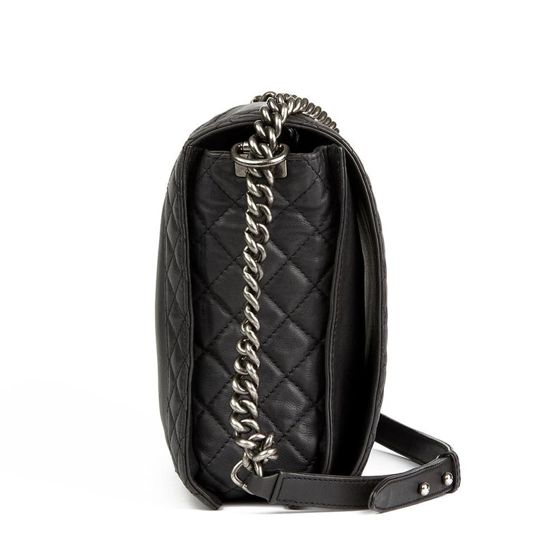 CHANEL Black Quilted Lambskin XL Le Boy Reverso    Reference: HB2006 Serial Number: 18845665 Age (Circa): 2014 Accompanied By: Chanel Dust Bag Authenticity Details: Serial Sticker (Made in France) Gender: Ladies Type: Shoulder  Colour: