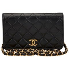 1990s Chanel Chanel Black Quilted Lambskin Vintage Mini Flap Bag