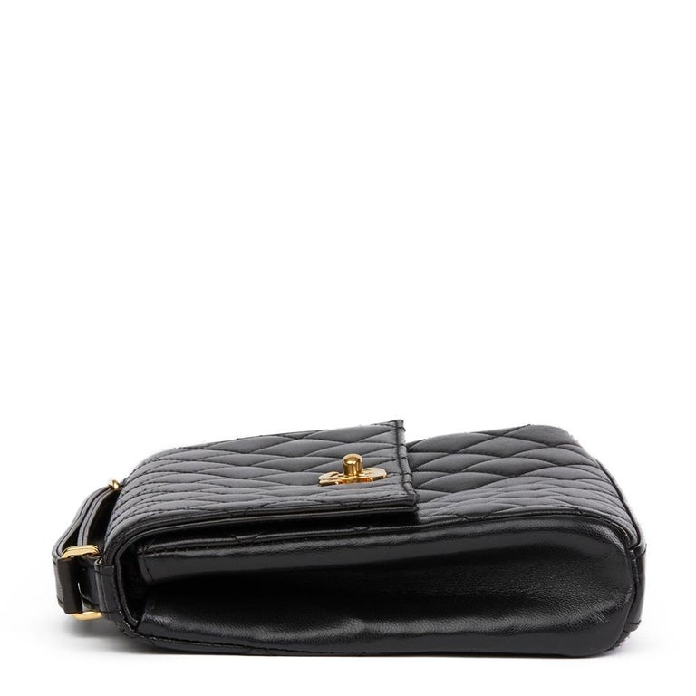CHANEL Black Quilted Lambskin Vintage Classic Top Handle Clutch   Xupes Reference: HB2082 Serial Number: 5474109 Age (Circa): 1997 Accompanied By: Chanel Dust Bag, Authenticity Card Authenticity Details: Serial Sticker (Made in France) Gender:
