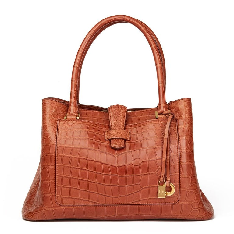 LORO PIANA Autumn Leaves Matte Crocodile Leather Bellevue Media  Xupes Reference: HB2149 Serial Number: 98493 Age (Circa): 2000 Accompanied By: Loro Piana Dust Bag, Charm, Leather Swatch Authenticity Details: Serial Number (Made in Italy) Gender: