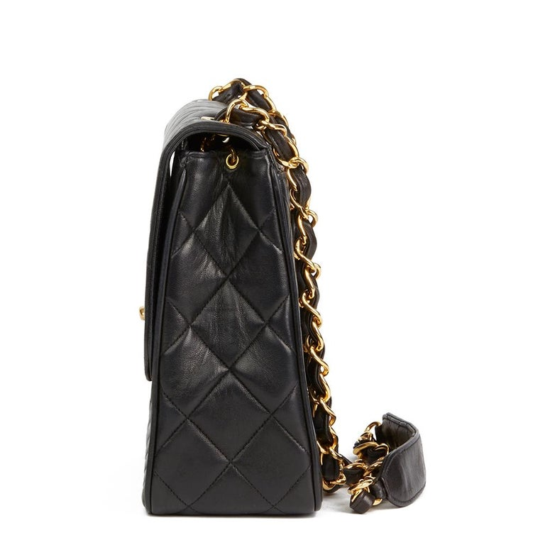 CHANEL Black Quilted Lambskin Vintage XL Classic Single Flap Bag  Reference: HB2139 Serial Number: 3233682 Age (Circa): 1994 Accompanied By: Chanel Dust Bag  Authenticity Details: Serial Sticker (Made in France) Gender: Ladies Type: Shoulder, Tote,