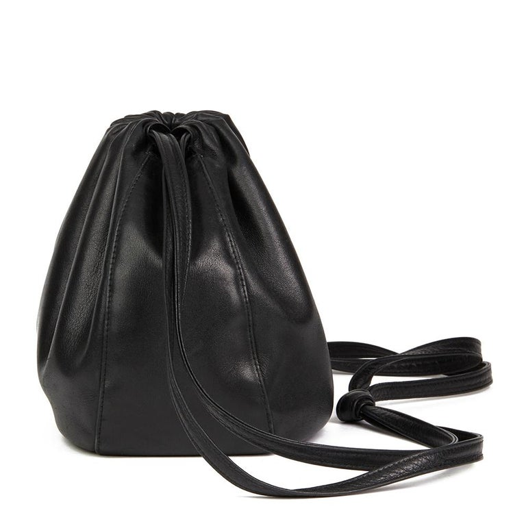 CHANEL Black Lambskin Vintage Timeless Bucket Bag  Reference: HB2158 Serial Number: 5772627 Age (Circa): 1998 Authenticity Details: Serial Sticker (Made in Italy) Gender: Ladies Type: Shoulder, Crossbody   Colour: Black  Hardware: Gold Material(s):