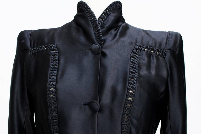 1935s Nina Ricci Haute -Couture Gorgeous Black Satin Jacket  : Rarissime; . The straight jacket long sleeves, and two pockets, is closed by a thin belt whose buckle is bakelite. The lead and the back of the jacket are underlined by silk satin