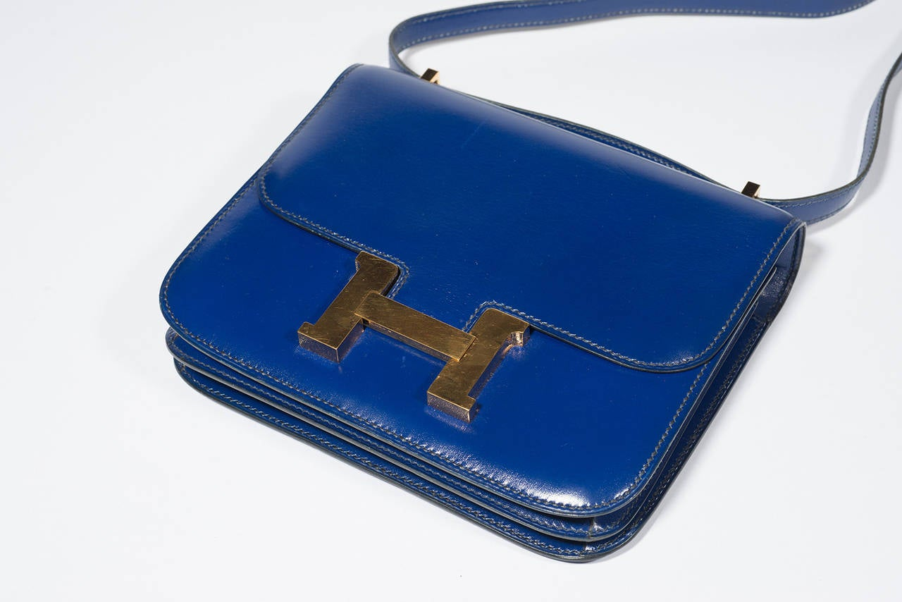 Hermès Constance  Divine Blue Leather bag :  Constance exceptional mini, blue roy 2 bellows. With its long shoulder strap 45 CM  15 CM /18CM/5 CM